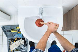 Professional Plumbers Providing Drain Cleaning Services